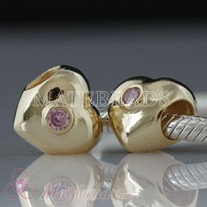 Gold plated silver heart bead with pink stones