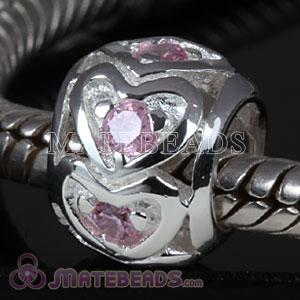 Sterling silver heart beads with pink stones